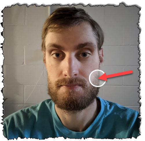 اسحب الدائرة إلى الموضع المطلوب لضبط الإضاءة في الصورة.