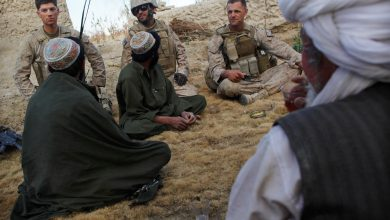 صورة ودعت طالبان الأفغان الذين يعملون في الجيش الأجنبي بتأمين أخبار طالبان